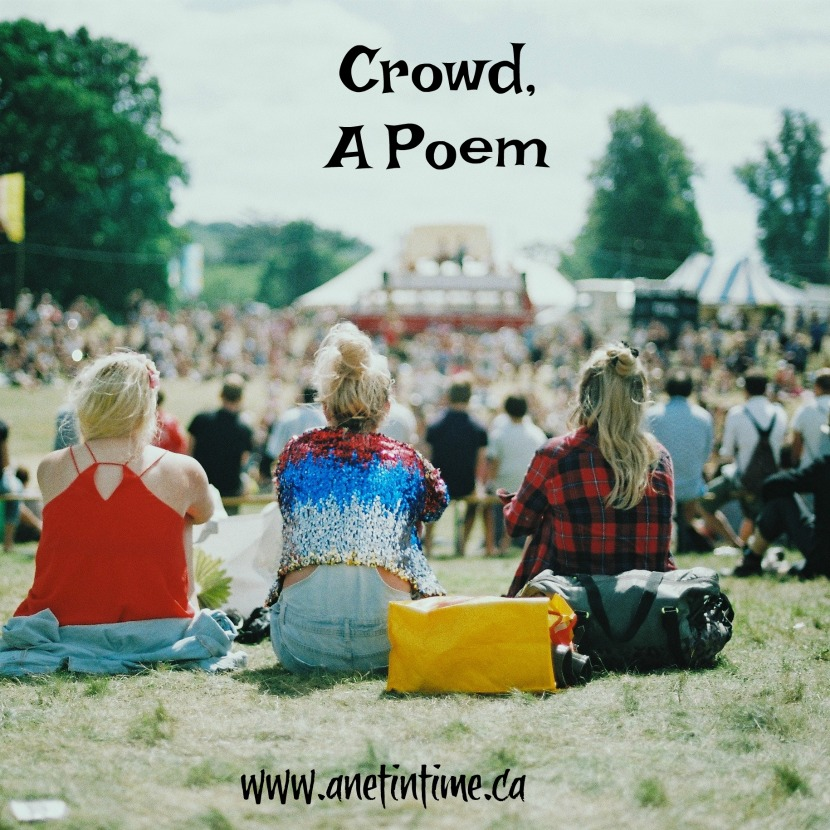 a crowd of people on grass, text crowd, a poem