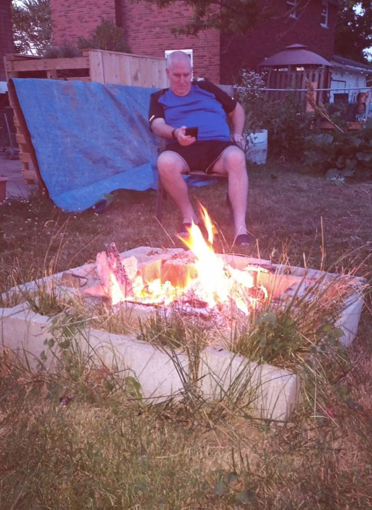 sitting around backyard fire
